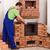 trabalhador · porta · alvenaria · aquecedor · metade · acabado - foto stock © lightkeeper