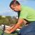 man on the roof fastening bitumen roof shingles stock photo © lightkeeper