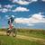pretty young female biker outdoors on her mountain bike stock photo © lightpoet