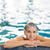 female swimmer in an indoor swimming pool   looking at the camer stock photo © lightpoet