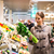 pretty young woman shopping for fruits and vegetables stock photo © lightpoet