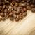 coffee beans on a wooden desk lit by warm light shallow dof co stock photo © lightpoet
