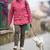 senior · vrouw · lopen · weinig · hond · straat - stockfoto © lightpoet