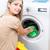 trabalhos · domésticos · mulher · jovem · lavanderia · colorido · máquina · de · lavar · roupa - foto stock © lightpoet