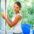 pretty young woman doing house work   washing windows stock photo © lightpoet