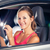 pretty female driver using her tablet computer stock photo © lightpoet