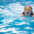 young girl in goggles and cap swimming breast stroke style stock photo © lightpoet