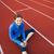 pretty female runner stretching before her run at a track stock photo © lightpoet