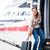 csinos · fiatal · nő · beszállás · vonat · város · városi - stock fotó © lightpoet