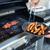 BBQ · kiełbasy · czerwony · mięsa · grill · mężczyzna - zdjęcia stock © lightpoet