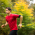 young man running outdoors in a city park on a fallautumn day stock photo © lightpoet