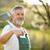 Portrait of a handsome senior man gardening in his garden stock photo © lightpoet
