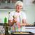 idős · nő · élvezi · étel · konyha · étel - stock fotó © lightpoet