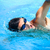 fiatalember · úszik · elöl · kúszás · medence · sport - stock fotó © lightpoet