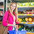 Beautiful young woman shopping for fruits and vegetables stock photo © lightpoet