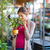 young woman buying flowers at a garden center stock photo © lightpoet