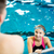 female swimmer in an indoor swimming pool talking to a friend stock photo © lightpoet