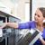 házimunka · fiatal · nő · edények · mosogatógép · ház · lány - stock fotó © lightpoet