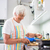 senior womangrandmother cooking in a modern kitchen stock photo © lightpoet