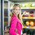 beautiful young woman shopping for fruits and vegetables in prod stock photo © lightpoet
