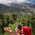 vrouw · wandelen · rugzak · bergen · parcours - stockfoto © lightpoet
