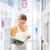 csinos · fiatal · főiskolai · hallgató · könyvtár · sekély · mélységélesség - stock fotó © lightpoet