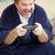 videojátékok · nyerő · versenyképes · fiútestvérek · játszik · otthon - stock fotó © lisafx