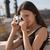 zsákmányolás · fény · fiatal · barna · hajú · nő · kamera - stock fotó © lithian
