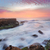 stunning sunrise and ocean flows over tidal rocks stock photo © lovleah