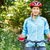 portrait of happy young woman riding mountain bike stock photo © luckyraccoon