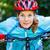 Happy Young woman leaned over the handlebars of her bike. stock photo © luckyraccoon