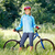 portrait of happy young woman with mountain bike outdoors stock photo © luckyraccoon