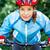 happy young woman leaned over the handlebars of her bike stock photo © luckyraccoon