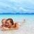mother with baby girl on summer beach stock photo © luckyraccoon
