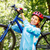 portrait of young woman with mountain bike on shoulder stock photo © luckyraccoon