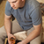 взрослый · человека · сидят · кровать · питьевой · домой - Сток-фото © luckyraccoon