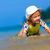 funny little girl playing on the beach stock photo © luckyraccoon