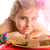 hungry gesture blond kid girl in party chocolates stock photo © lunamarina