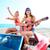 girls having fun playing guitar on th beach in a car stock photo © lunamarina