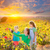 Mother and daughters on autumn vineyard smiling holding grape stock photo © lunamarina