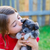 children girl kissing her puppy chihuahua doggy stock photo © lunamarina