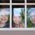 three sister friends looking through the rainy window stock photo © lunamarina