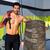 crossfit sledge hammer man at gym relaxed stock photo © lunamarina