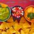 nachos · tomate · salsa · queso · salsa · aguacate - foto stock © lunamarina