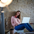 Businesswoman casual sitting at office with laptop stock photo © lunamarina