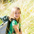 ontdekkingsreiziger · kid · meisje · lopen · rugzak · gras - stockfoto © lunamarina