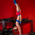 kettlebell handstand woman workout in red gym stock photo © lunamarina