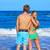 blond young couple standing looking at the beach stock photo © lunamarina