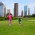 Two sister girls friends running holding hand in urban skyline stock photo © lunamarina