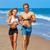 を実行して · ジョギング · 海浜砂 · 幸せ · 小さな - ストックフォト © lunamarina